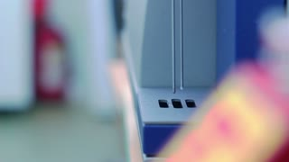 Milk analysis. Analysis of milk sample on laboratory equipment. Modern equipment. Scientist put glass with milk in laboratory equipment for research. Food quality test