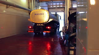 Milk truck leaves the dairy factory. Dairy industry machinery. Milk tanker full of milk leaves dairy farm. Milk transportation