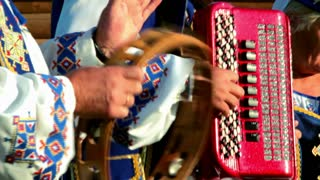 Musicians play on folk instruments
