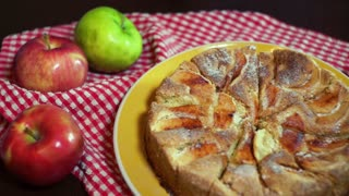 Piece of freshly baked cake taking out with the help of knife. Chef taking slice of cake. Baked apple cake. Home baking. Traditional autumn dessert