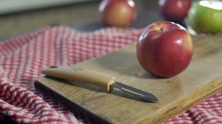Process cutting peel of fresh apple. Preparing diet food. Hands cut peel apple. Ingredients to baking apple cake. Peeling apples with special knife for peeling fruits. Vegetarian food