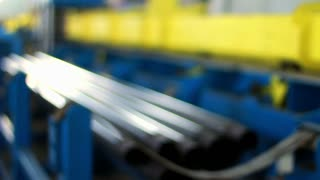Production of pipes at the plant. Production process of steel pipes at factory. Production process in heavy industry. Industrial machinery for production line of pipes. Pipes production technology