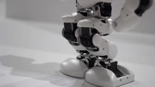 Robot legs dance. Robot dance steps. Close up of robot legs dancing. Science robots. Mechanical technology. Robotic leg. Closeup of humanoid robot foot dance