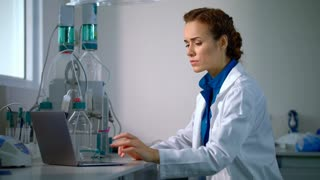 Scientist working with modern laboratory equipment in lab. Doctor conducting research. Researcher in lab. Lab worker wear safety glasses. Clinician doing scientific experiment. Chemical research