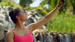 Selfie girl. African girl taking selfie photo with phone. Latin woman taking selfie in park. Happy woman taking self photo. Selfie portrait. Woman selfie. Girl making selfie. Selfie girl. Self photo