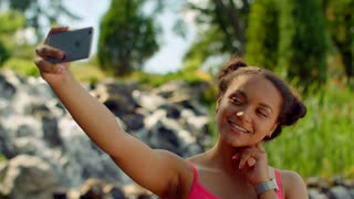 Selfie girl. Close up of latin girl taking selfie photo. Mulatto girl taking selfie at park in summer. African girl taking photo with phone outdoor. Iphone selfie. Selfie phone. Self portrait