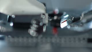 Sewing needle in slow motion. Sewing machine needle work process. Sewing needle working. Sewing machine slow motion. Manufacturing equipment. Process of working of the electric sewing machine.