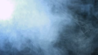 Smoke background. Abstract blue smoke cloud. Smoke in slow motion. White smoke slowly floating through space against black background. Smoke effect. Fog effect. Smoke machine. Studio shot