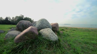 Stack of large gray stones on lake shore