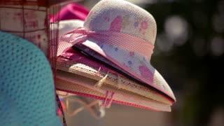 Summer hat .Closeup of straw hat. A few beach hats. Pretty straw hat with ribbon. Beach fashion. Sun hat. Sun protection. Woman accessory