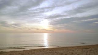 Sunrise beach. Idyllic scene of sea sunrise. Sea waves slowly splashing sand. Sunrise sea. Beautiful seascape. Nature sunrise with calm water. Beach sunrise. Pov walking on sea beach at morning