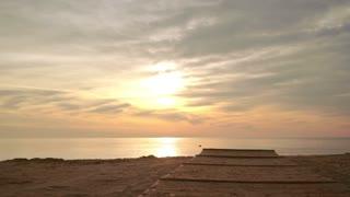 Sunrise beach. POV walking on beach. First person shot of sea sunrise. Sunrise sea. Walking on beach at sunrise. Sunrise sky. Tranquil water at sunrise sea. Beach sunrise. Point of view.