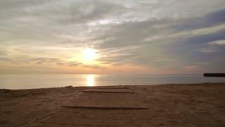 Sunset beach. Pov walking on sea beach. Pov shot of sea sunset at sand beach. Sunset sea. Walking on beach at sunset. Sunset sky. Tranquil water at sunset sea. Beach sunset. Point of view