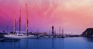 Sunset sky over yachts in marina. Timelapse of pink sky over yacht port. Clouds sky over sailboats in marina. Sail boats in yacht marina at sunset. Clouds sky over sea port in dusk