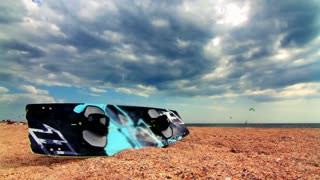 Surfboard lying on the beach sand. Time lapse. Surf board on sand at sea beach. Sea beach. Beach scene. Ocean beach