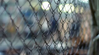 The production process for rabitz. Metal wire fence in industrial workshop. Closeup of steel wire protection