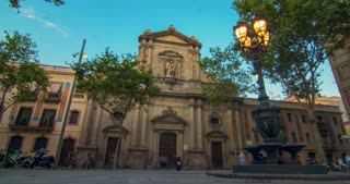 Travel landmarks of Barcelona at sunset. Theater facade, Barcelona. Time lapse of landmarks in Spain at sunset. Tourists walking near old building in Barcelona at evening. European architecture
