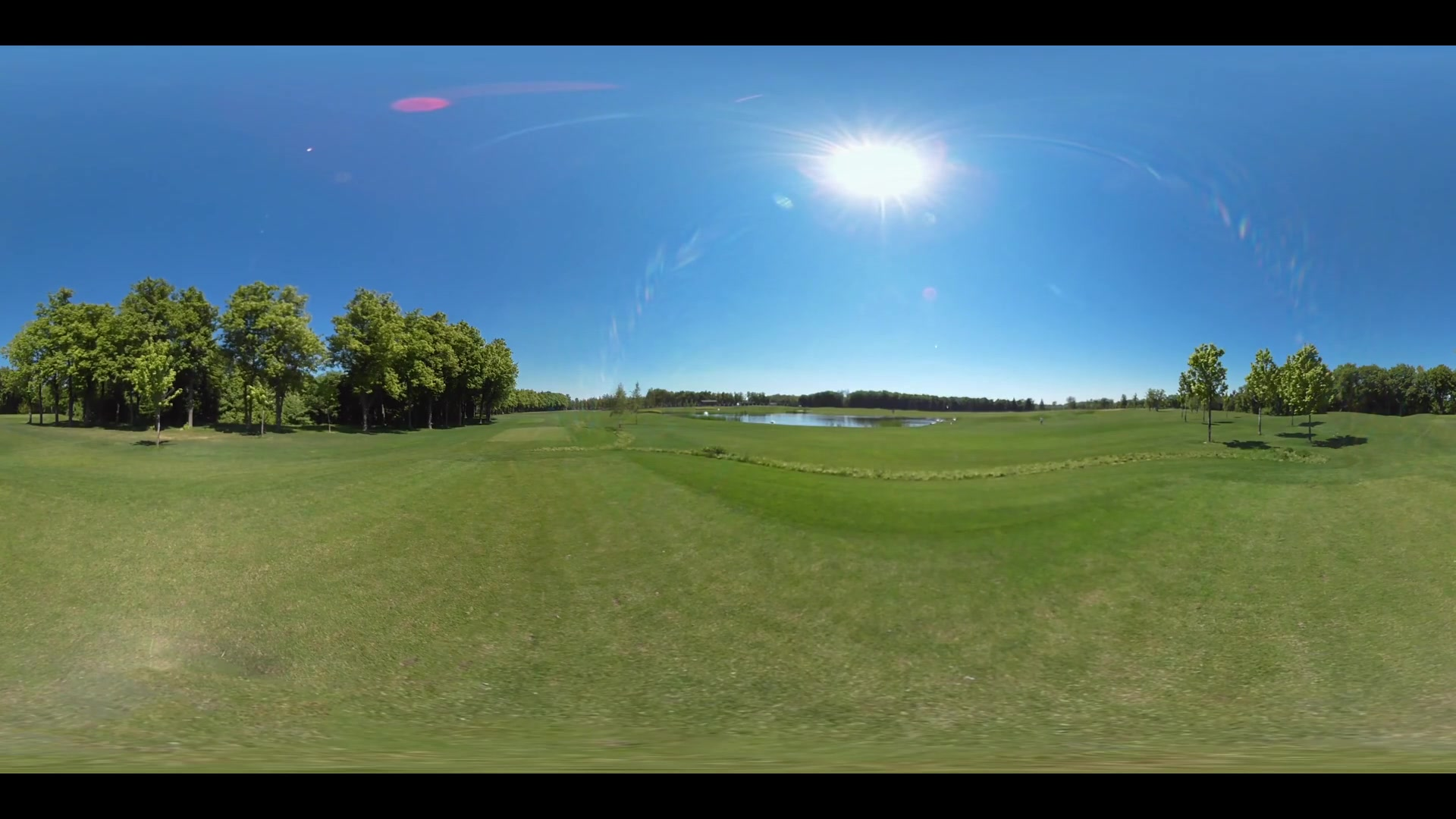 360 panorama of green meadow grass. Green grass field blue sky 360 view. Green lawn grass golf field 360 degree panorama. Lake on green lawn landscape