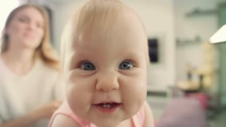 Adorable baby face looking in camera. Portrait of happy child exploring world. Cute kid interesting around things. Close up of infant playing at home. Sweet child looking up