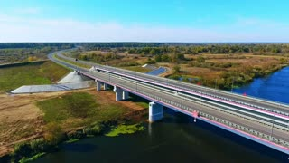 Aerial landscape highway road over river. Drone view road bridge at nature landscape. Beautiful aerial road landscape. Highway bridge view from above. River road landscape high view