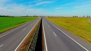 Aerial landscape road in field. Top view straight road. Cars traffic highway sky view. Cars moving on highway road. Highway landscape. Road aerial view