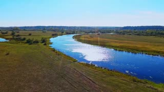 Aerial river landscape. Beautiful river aerial view. Summer nature field water sky view. Top view river field landscape. Summer river nature landscape. Aerial nature water field