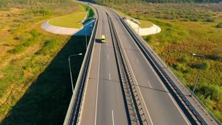 Aerial view of highway road. Car bridge. Bird eye view of transport on highway road. Truck driving over bridge. Aerial landscape of highway road. Drone view of highway landscape