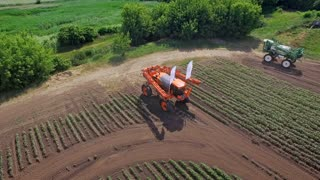 Agriculture fertilizer. Spraying machine on agricultural field transformed for fertilizing plant. Drone view agricultural sprayer preparing to irrigate on farming field. Agricultural industry
