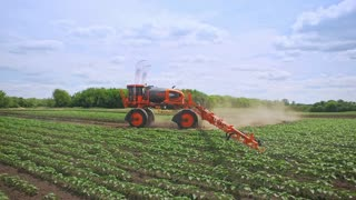 Agriculture irrigation machine. Agricultural machinery watering field. Farming agriculture machine for irrigation field. Agriculture industry work. Agricultural machinery