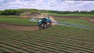 Agriculture irrigation machine. Irrigation agriculture equipment. Agricultural sprayer watering fertilizer on farming field. Aerial view watering field. Farming equipment. Agricultural industry