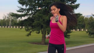 Asian woman running in park. Closeup of fitness woman running outdoor. Running woman in slow motion. Outdoor fitness workout. Close up of sport woman running workout. Healthy lifestyle concept