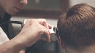 Barber haircut. Hairdressing. Close up of male hair dressing. Man haircut with electric shaver. Man getting haircut. Barber hair cut with hair trimmer. Man hairstyle