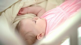 Beautiful girl sleeping in cot. Awesome baby dream. Bedtime for toddler. Sweet dream for kid. Baby care. Infant girl sleeping in white crib. Dreaming sleeping. Child relax. Cute kid lying in bed