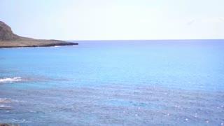 Beautiful rocky shore landscape. Summer stone seashore. Sea panorama with stony mountains. Sunny weather at rocky coastline. Stone mountain at coast line. Nature landscape