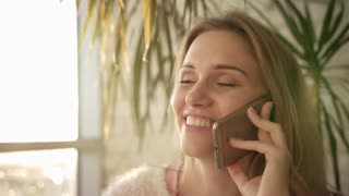 Beautiful woman talking mobile. Close up of speaking woman face with telephone. Smiling girl speaking phone. Pretty girl talking mobile. Portrait of successful woman talking on phone