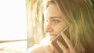 Beautiful woman talking phone. Beauty girl talking mobile. Portrait of talking woman smile. Tenderness connection concept. Face of girl speaking with friend on smartphone. Morning conversation