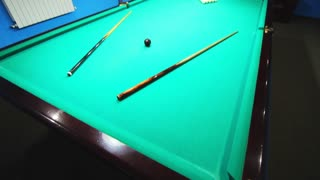 Billiard table before game. Lighted billiard room background. Billiard balls on green pool table. Pool table balls. Pool game room. Snooker ball on snooker table