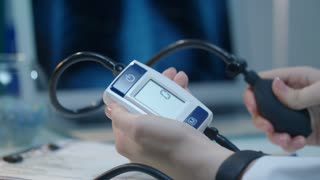 Blood pressure monitor. Close up of female hand hold blood pressure monitoring. Blood pressure check equipment. Hypertension concept