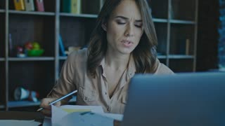 Business market analyst working with market report. Concentrated businesswoman analyzing finance report. Business research. Focused business woman analyze documents. Female worker with serious face