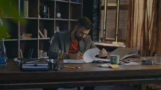 Businessman signing document at office. Tired man working with papers. Serious businessman reading business contract at home office. Handsome worker concentrating on document work at workplace