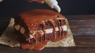 decorating chocolate biscuit wedding cake cinemagraph pouring the chocolate for dessert in the 13405