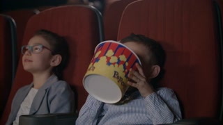 Children Eat Popcorn In Cinema Preschool Children Watching Movie In Cinema Boy Taking Popcorn From Box In Movie Theatre Kids Eating Popcorn In Movie Theater Movie Entertainment Industry Stock Video Footage