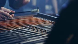 Cimbalom string music instrument. Close up of cimbalom string. Male musician playing cimbalom music. String music instrument. National string instrument. Hammered dulcimer