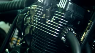 Classic motorbike in customs garage. Close-up of motorcycle engine and headlight. Vintage style cafe racer motorcycle. Rockabilly lifestyle and man hobby. Motorcycle background. Vintage motorbike
