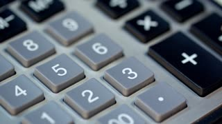 Close up of woman hand using calculator. Female accountant calculate numbers on calculator. Bookkeeper using calculator. Business accounting and money profit calculation. Family budget calculation