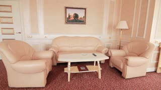 Comfortable room with apartment furniture in classical design. Room furniture sofa and armchairs for recreation in hotel apartment