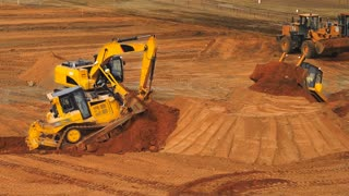 Construction equipment at mining quarry. Construction machinery working on construction site. Mining industry. Mining machinery. Caterpillar equipment moving ground with scroop