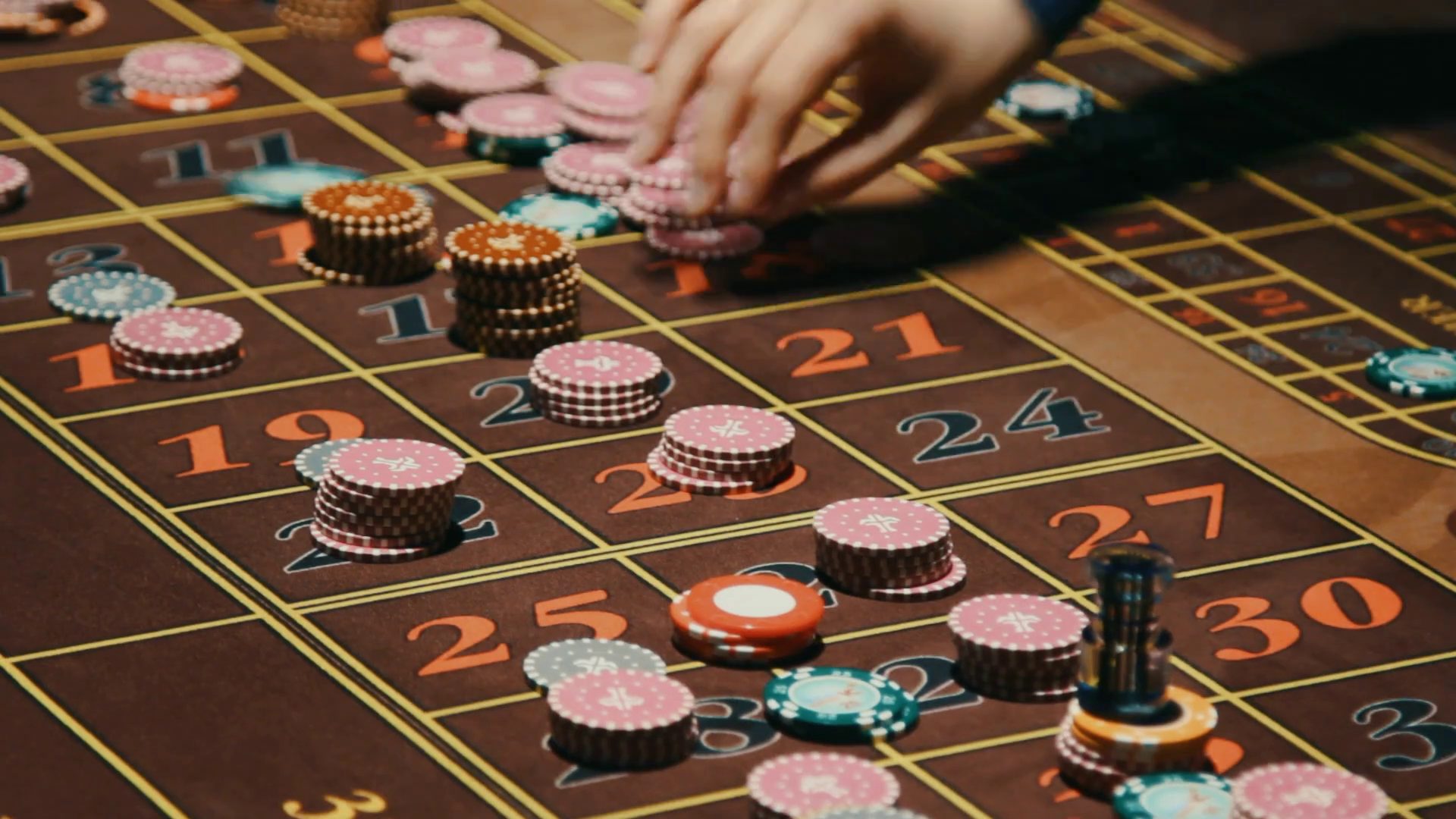 Croupier Hands Removing Casino Chips From Gambling Table Casino Roulette Table With Classic Betting Grid Close Up Casino Dealer Hands Clean Up Table From Game Bets Gambling Game In Casino Stock Video