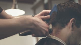 Cutting hair with electric razor. Close up of male haircut. Man hairstyle. Male hair cut. Barber cut. Barber haircut. Man hairdresser. Man haircut with electric shaver. Hairstyle man