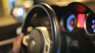 Driving car wheel. Close up of drive wheel car. Auto dashboard. Driver hand holding car wheel. Car driving at night. Driving wheel. Auto driving. Auto driver hand